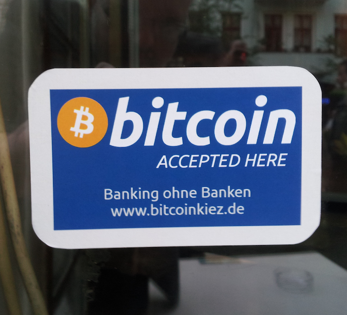 Sign in shop window: Bitcoin accepted here